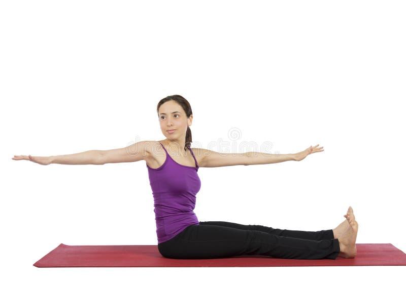 Woman doing pilates abs exercises royalty free stock photo