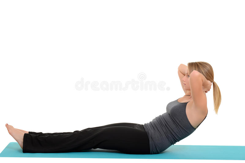 Woman doing pilates neck pull royalty free stock photo