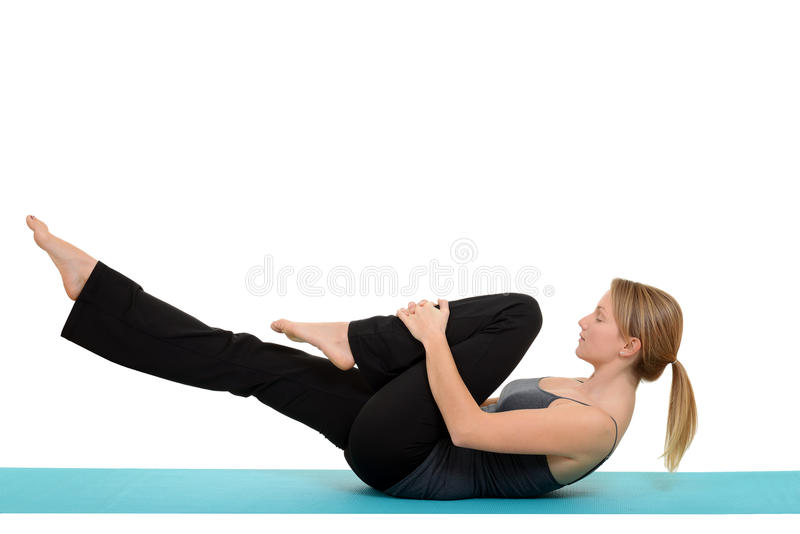 Woman doing Pilates single leg stretch royalty free stock image