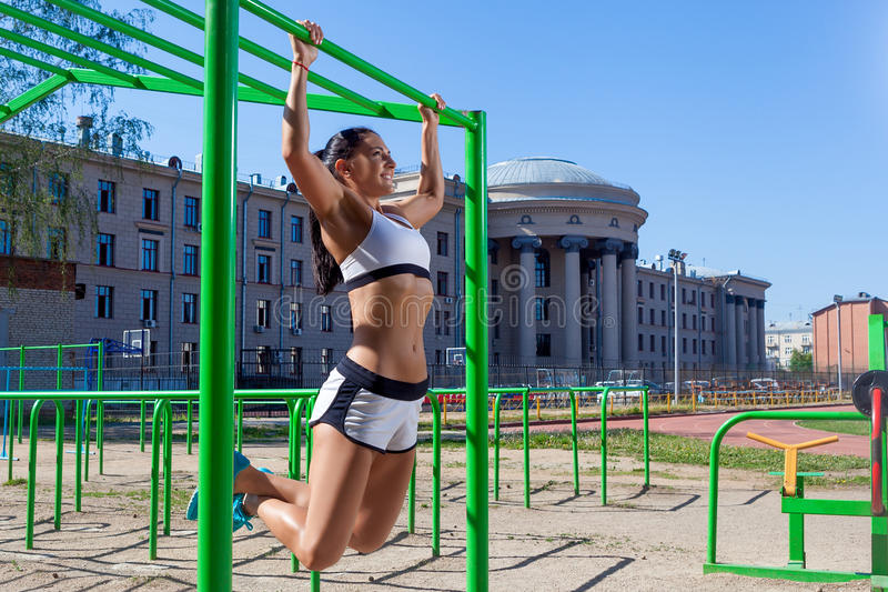 Woman doing pull-up royalty free stock images