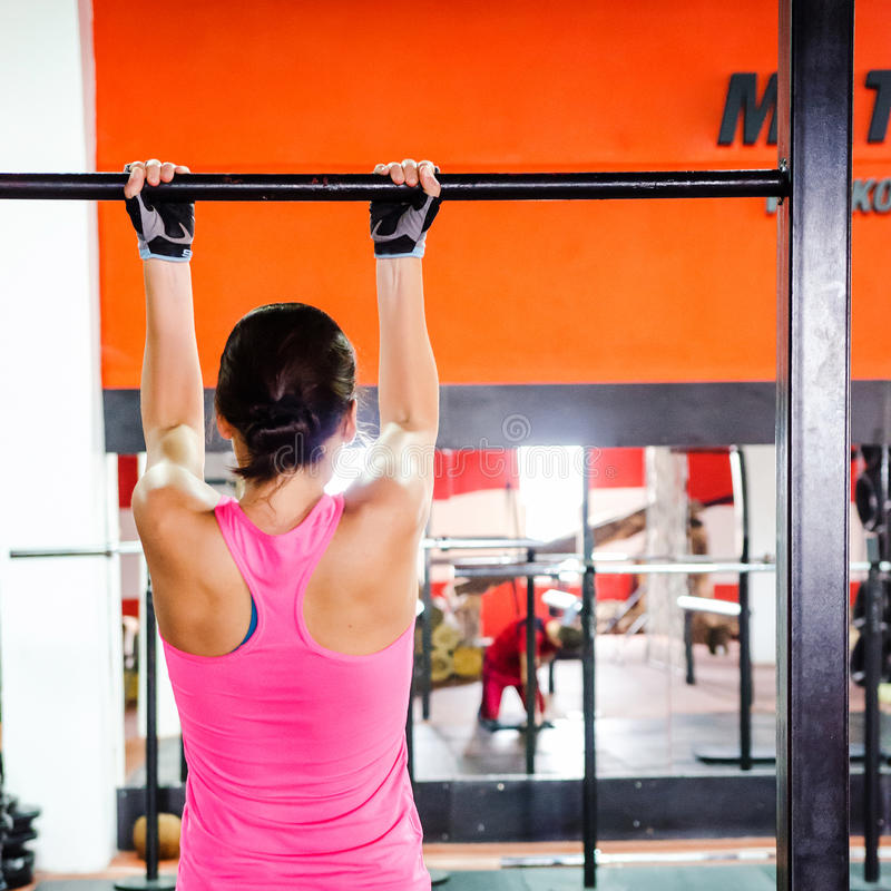 Woman doing pull-ups stock images