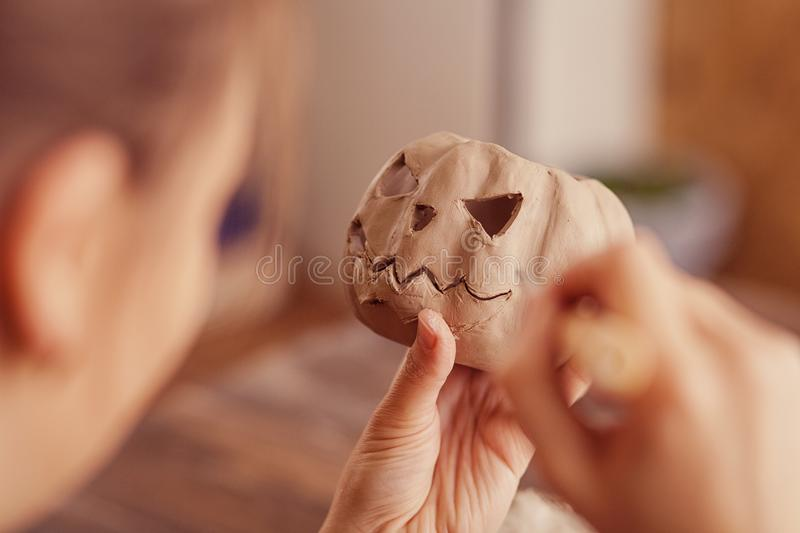 Woman doing on a pumpkin face jack stock photography