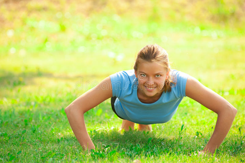 Woman doing push up exercise royalty free stock photos