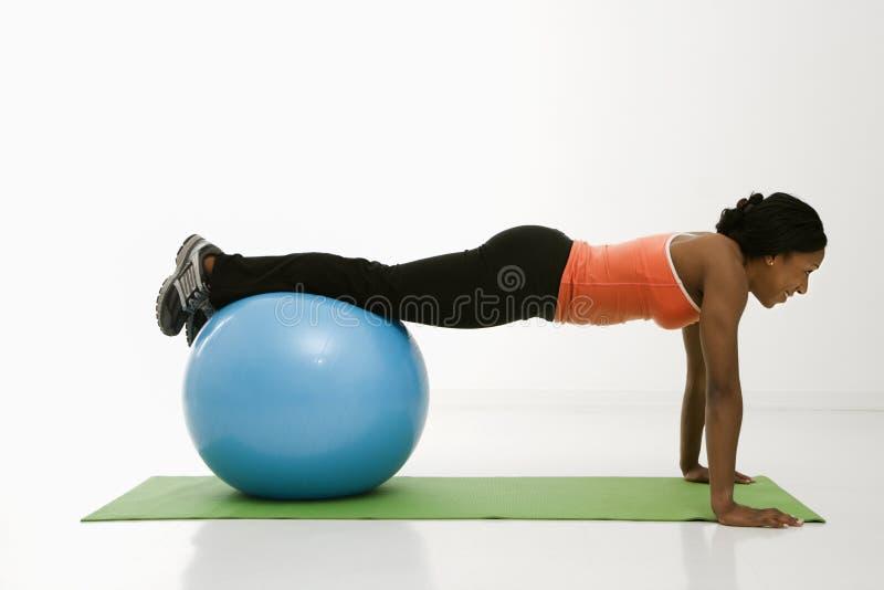 Woman doing push ups. royalty free stock photo