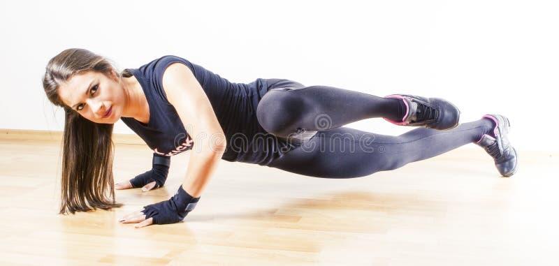 Woman doing push ups stock photo