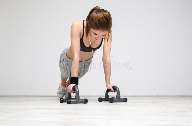 Woman doing push ups at gym royalty free stock photos