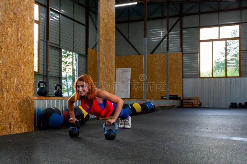 Woman doing push-ups stock images