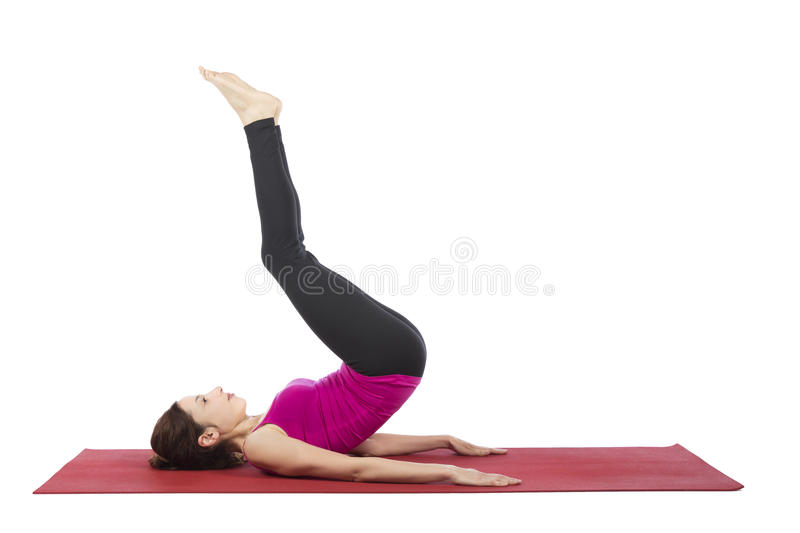 Woman doing reverse crunch during fitness. Woman is doing reverse crunch pose in fitness stock image