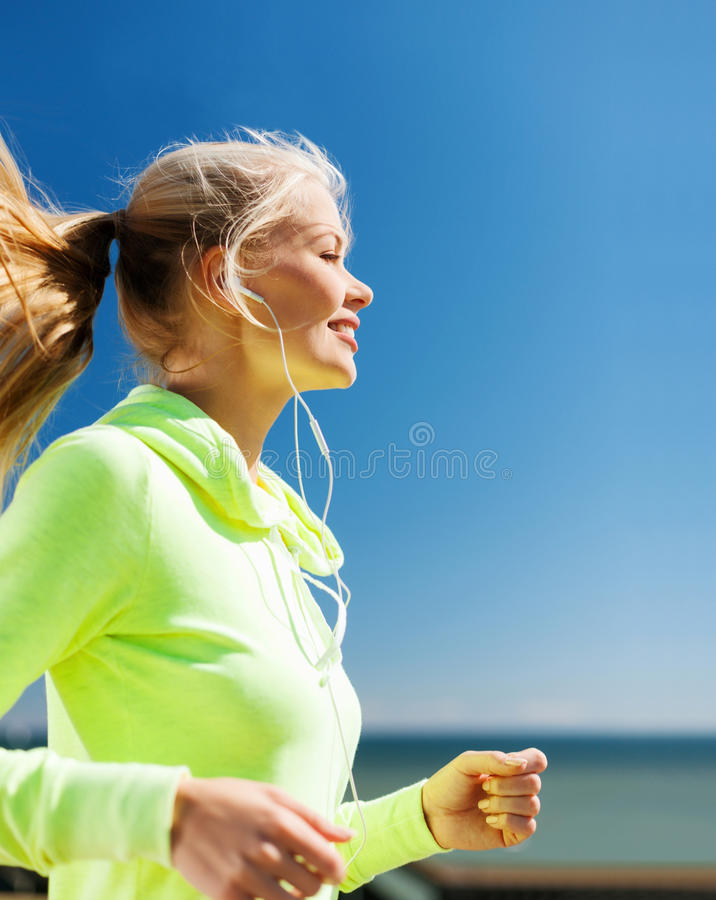Woman doing running outdoors stock photos