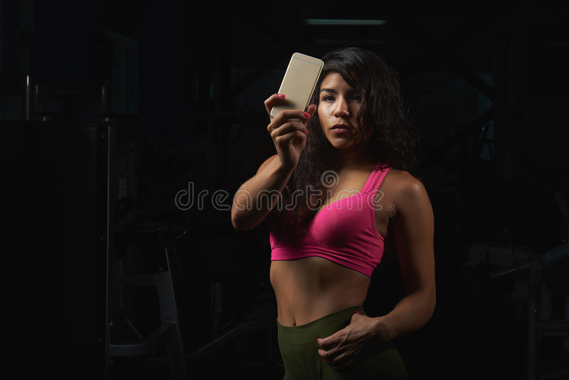 Woman doing selfie in fitness club royalty free stock image