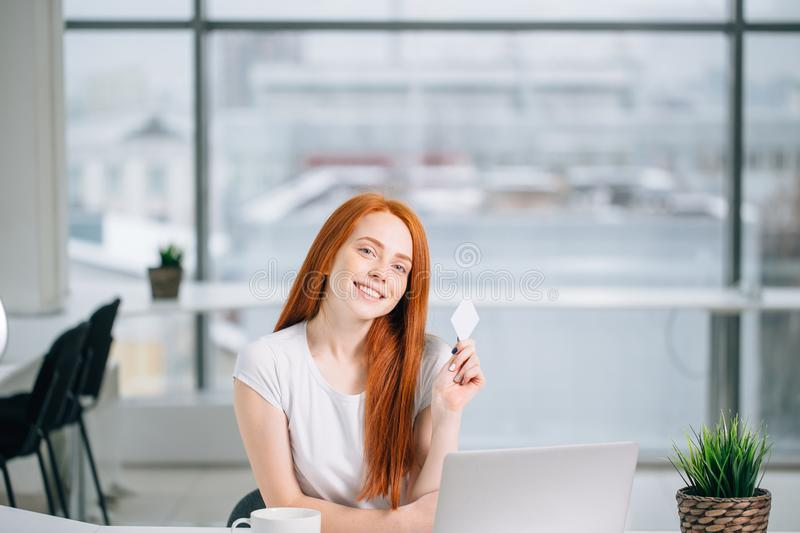 Woman doing shopping online with her laptop at home royalty free stock photography