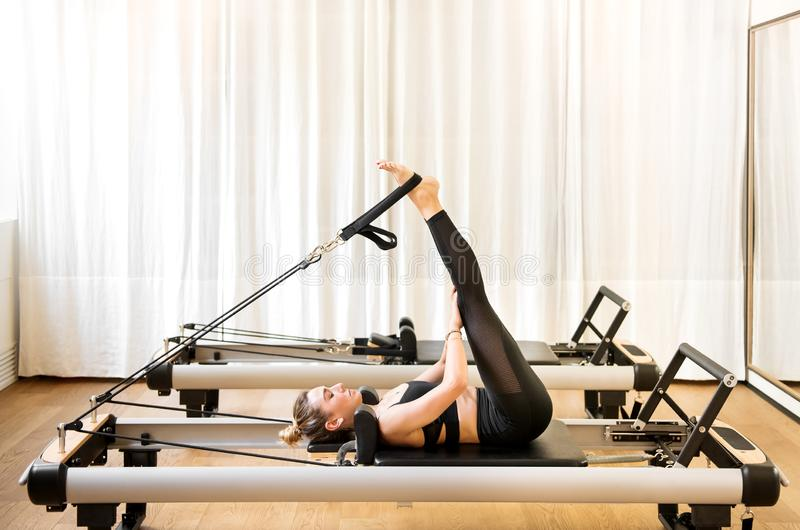 Woman doing short spine pilates exercises royalty free stock photos