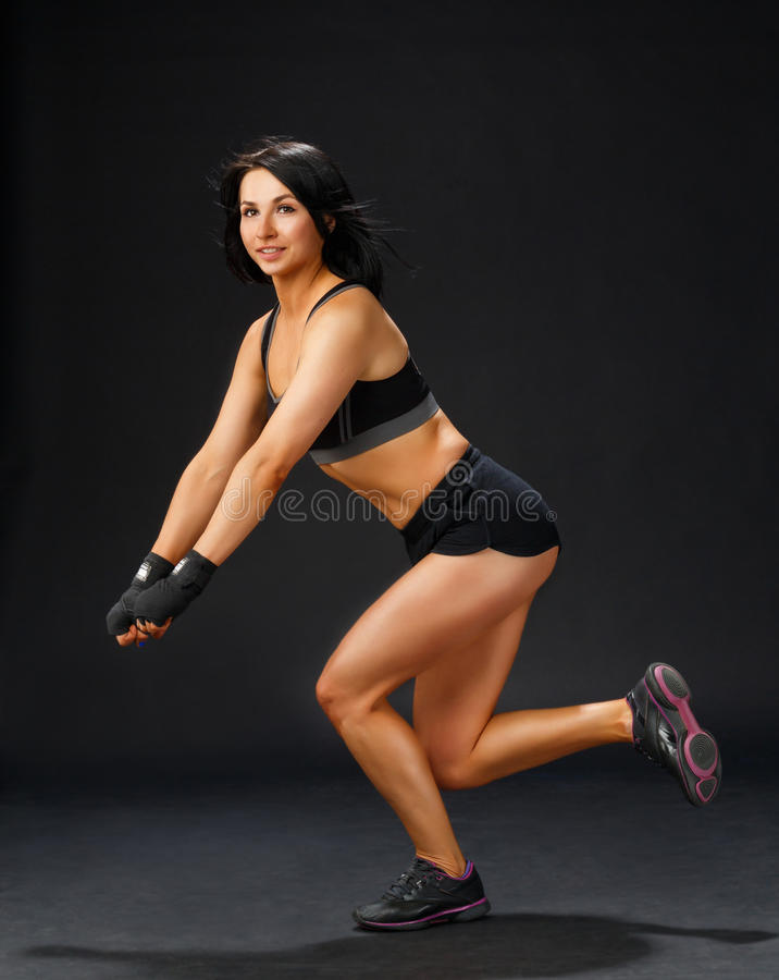 Woman doing single leg squatting royalty free stock image
