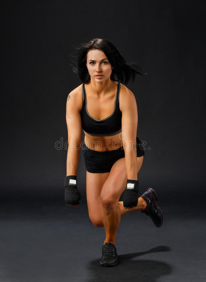 Woman doing single leg squatting stock images