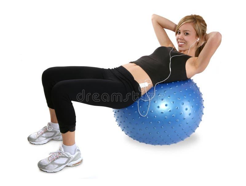 Woman Doing Sit-Ups Stock Photo