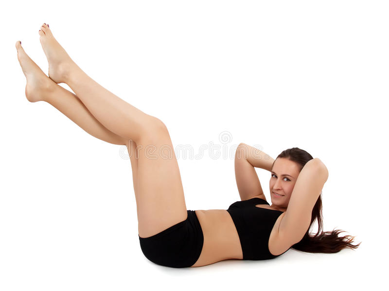 Woman doing sit ups royalty free stock photography