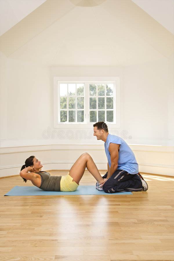 Download Woman doing sit ups stock photo. Image of recreation, partner - 4415564