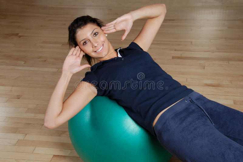 Download Woman Doing Sit Ups With Swiss Ball Royalty Free Stock Photo - Image: 14694055