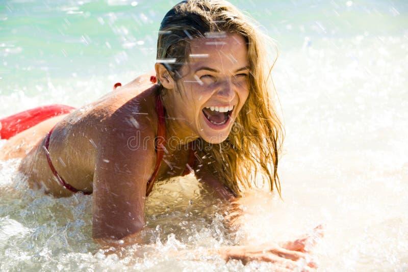 Woman doing splashes stock photography