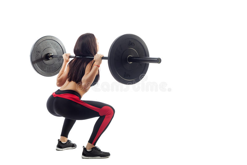 Woman doing squat with a barbell royalty free stock photos