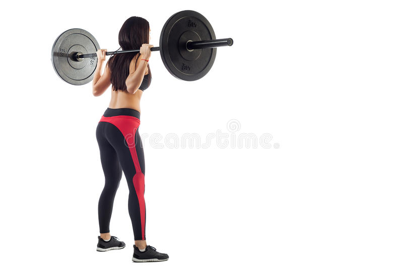 Woman doing squat with a barbell stock photo