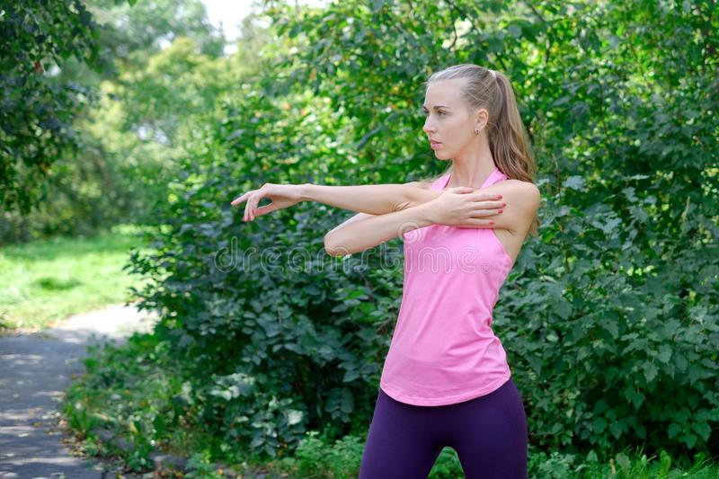 Woman doing stretching exercise in park royalty free stock images