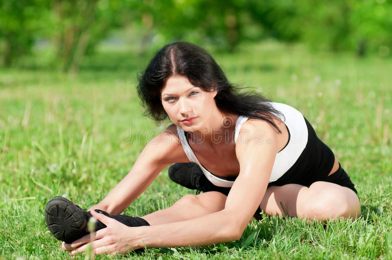 Woman doing stretching exercise. Yoga royalty free stock photos