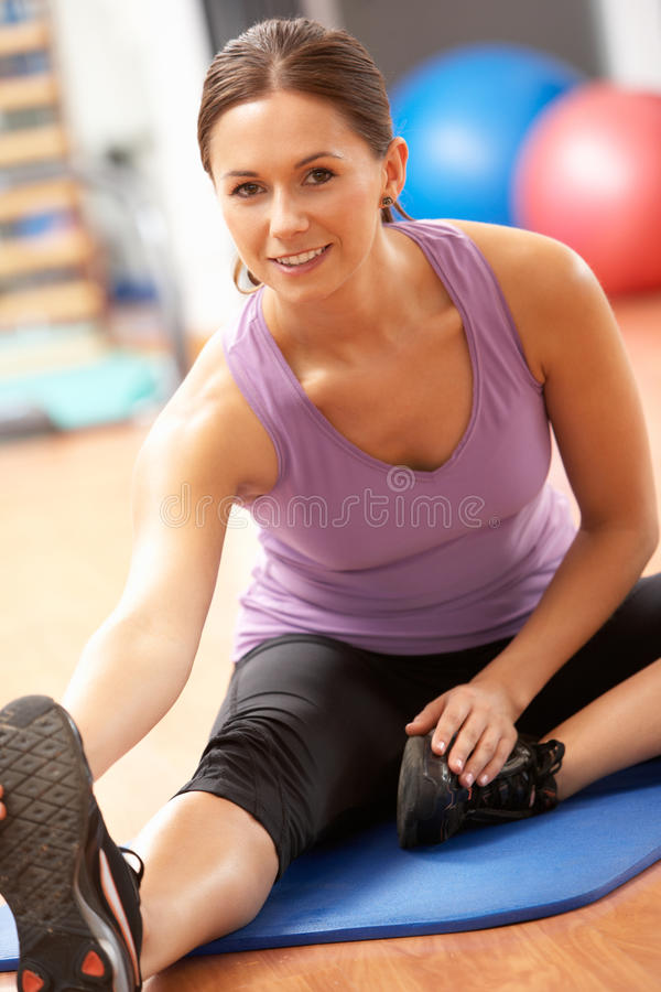 Download Woman Doing Stretching Exercises In Gym Stock Image - Image of stretch, sitting: 16301117