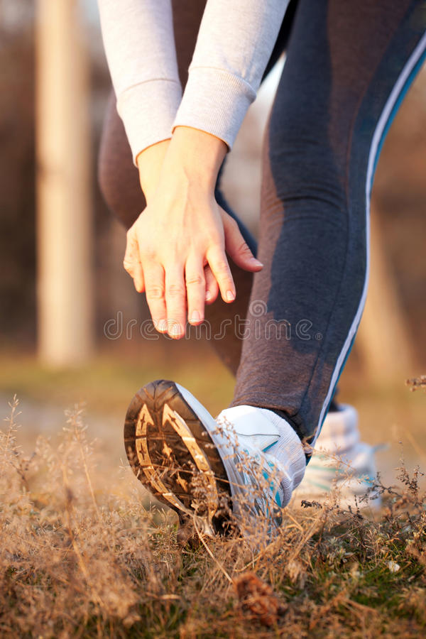 Woman doing stretching exercises. Healthy lifestyle concept. Middle-aged sporty woman doing stretching exercises. Healthy lifestyle concept stock photo
