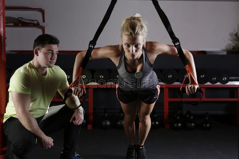 Woman doing TRX training royalty free stock image