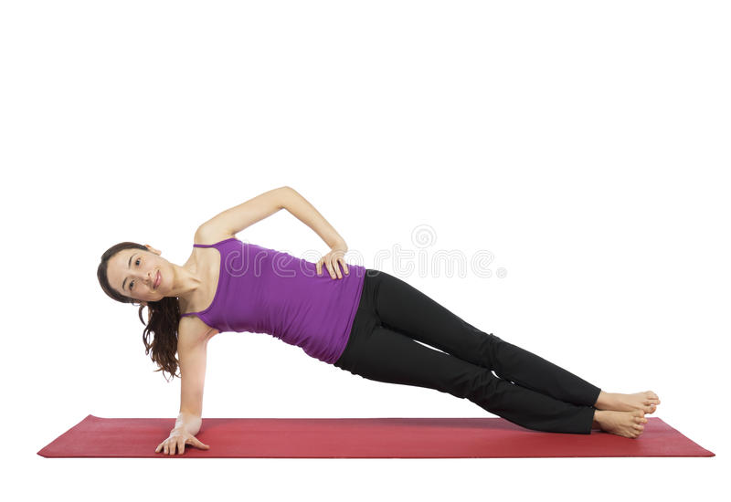 Woman doing a variation of side plank pose stock photography