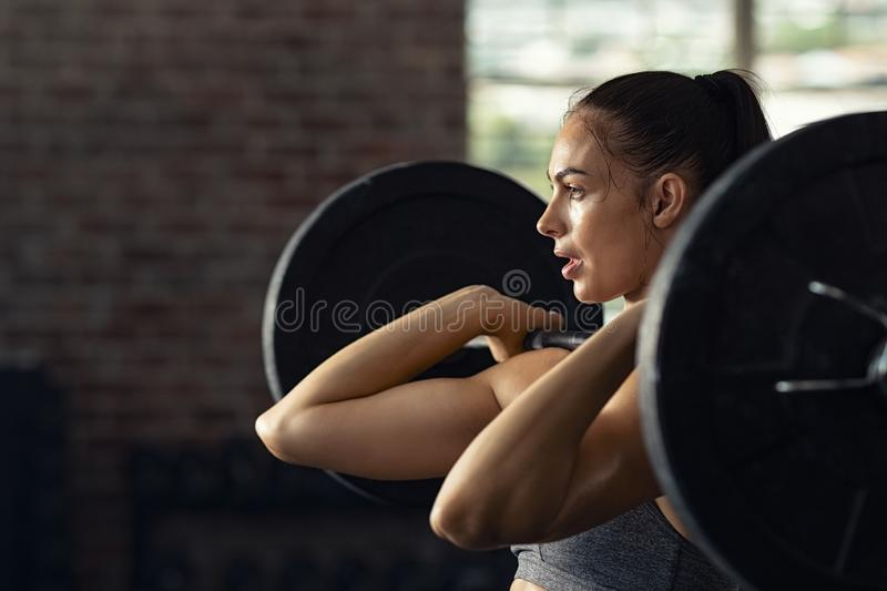 Woman doing weight lifting at cross fit gym stock photography