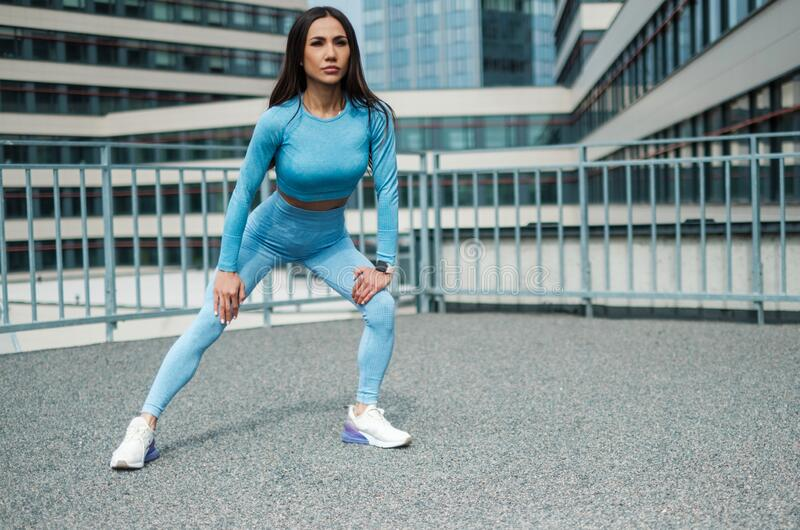 Woman doing workout alone on a roof royalty free stock photo