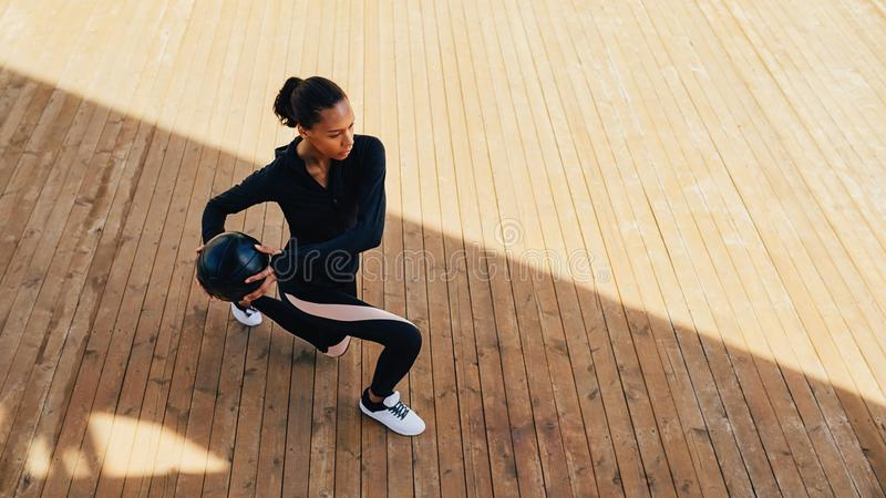 Woman doing workout with medicine ball royalty free stock photo