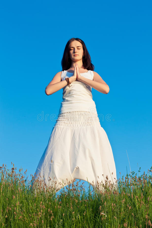 Download Woman doing yoga stock image. Image of field, outdoors - 24993031