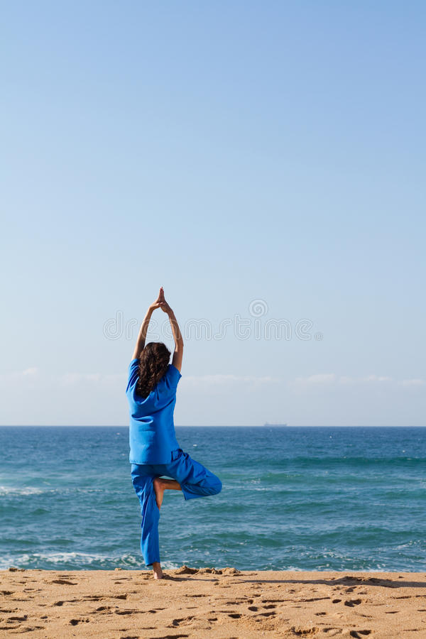 Download Woman doing yoga on beach stock image. Image of back - 14330353