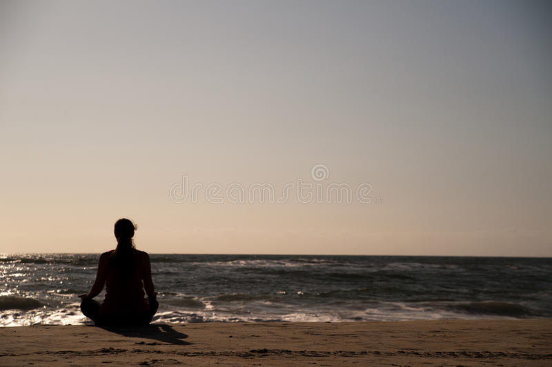 Download Woman doing yoga on beach. stock photo. Image of balance - 16628786