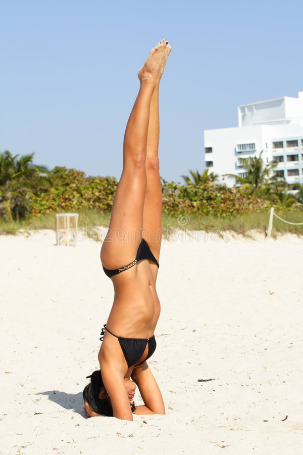 Download Woman Doing Yoga On The Beach Stock Image - Image: 4565121