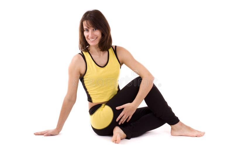 Woman doing yoga exercise stock photos