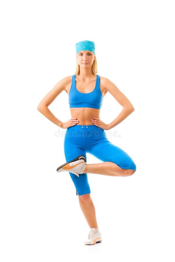 Woman doing yoga exercise. Beautiful young woman doing yoga exercise isolated on white background stock photography