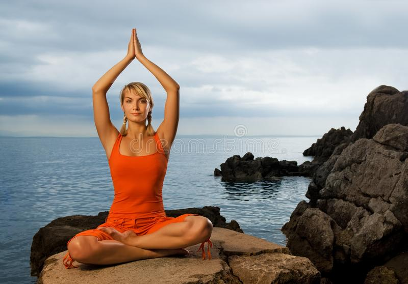 Woman doing yoga exercise royalty free stock photos
