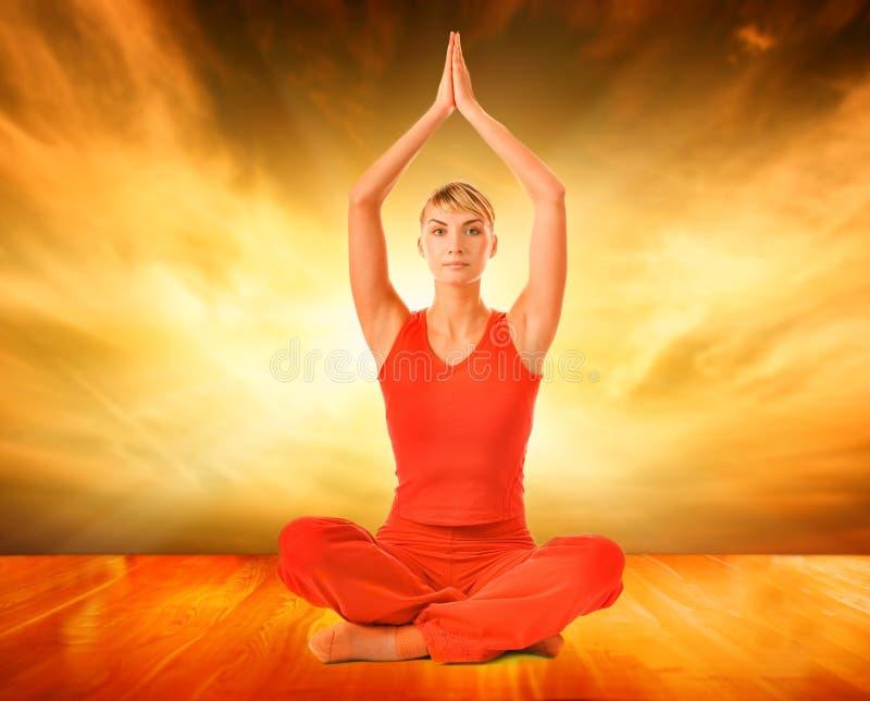 Woman doing yoga exercise. Beautiful young woman doing yoga exercise stock images