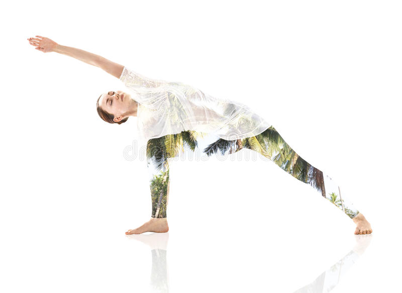 Woman doing yoga exercise and foliage. Double exposure of woman doing yoga exercise and foliage royalty free stock photos