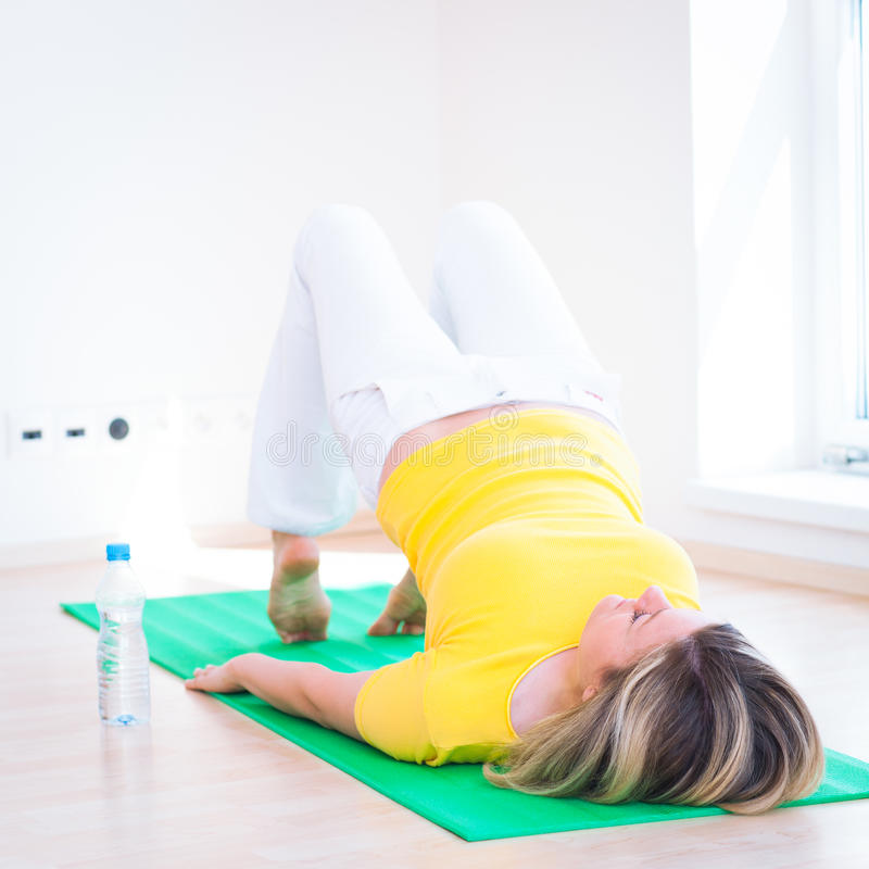 Woman Doing YOGA Exercise At Home Royalty Free Stock Photo