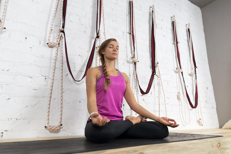 Woman Doing Yoga Exercises In Gym, Sport Fitness Girl Sitting Lotus Pose. Meditation Relaxation royalty free stock photography