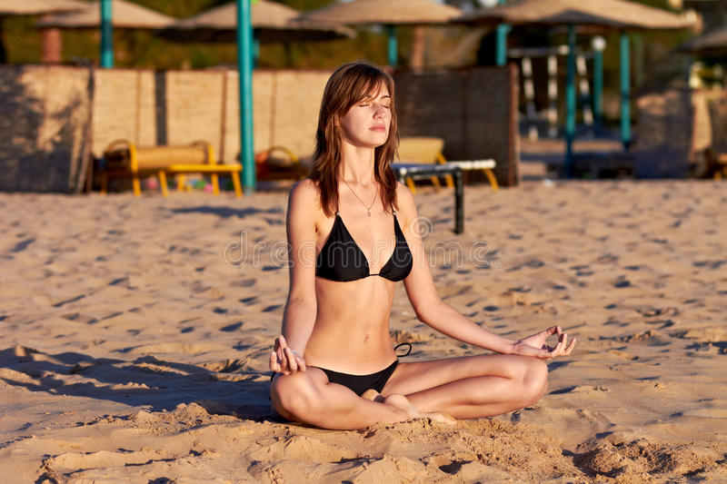 Download Woman Doing Yoga Meditation In Lotus On The Beach Stock Image - Image: 23061383