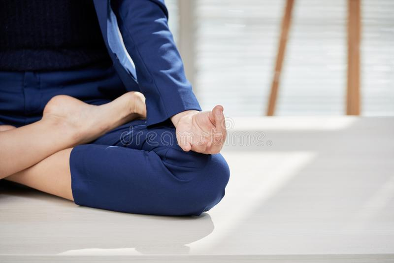Woman doing yoga at office stock photo
