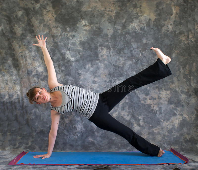 Woman Doing Yoga Posture Vasisthasana Royalty Free Stock Photography