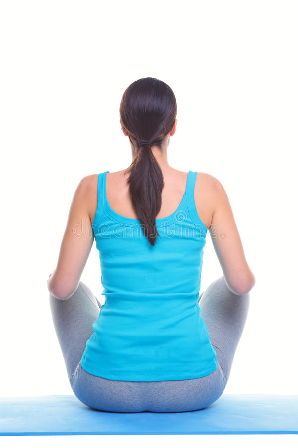 Woman doing yoga rear view stock images