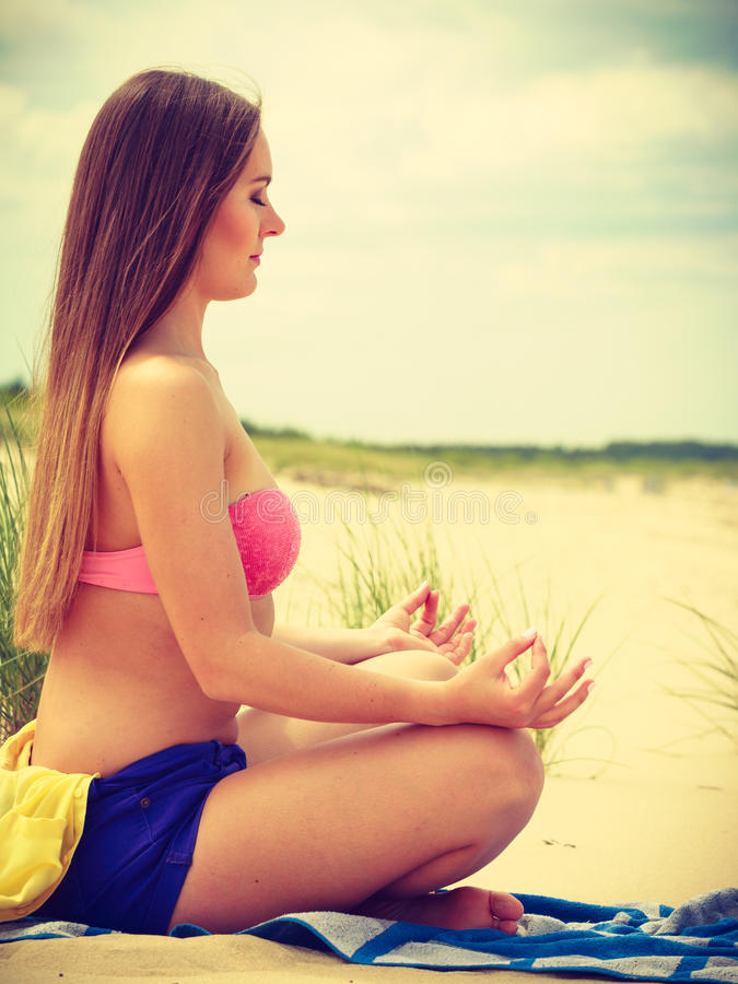 Download Woman Doing Yoga On Sandy Beach. Stock Photo - Image: 83710187